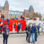i.amsterdam.slogan.crowd.tourists.april.april.located.back.rijksmuseum.54512205